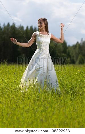 Young Girl In A Wedding Dress Dancing