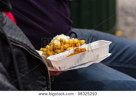 Man Holding A Street Food