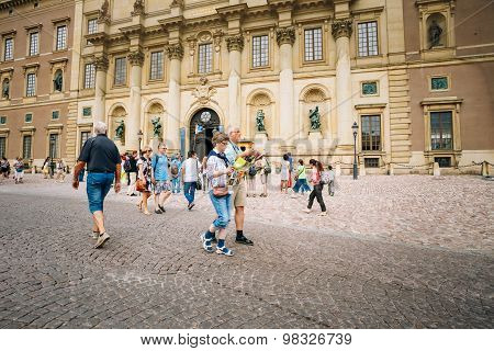 Tourists visit the Royal palace in Gamla Stan, where king Carl X