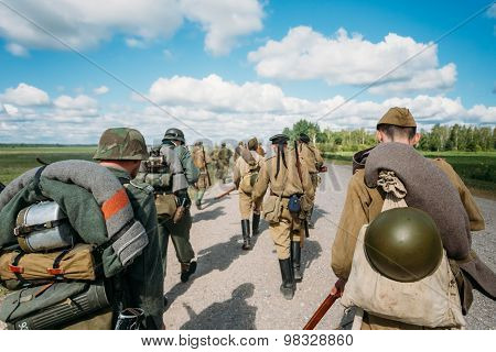 Unidentified re-enactors dressed as German and Soviet Russian so