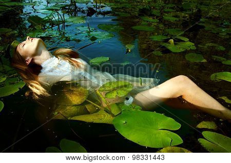 Tender Young Woman Swinning In The Pond Amon Water Lilies