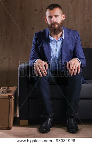 Businessman sitting on sofa in office lobby