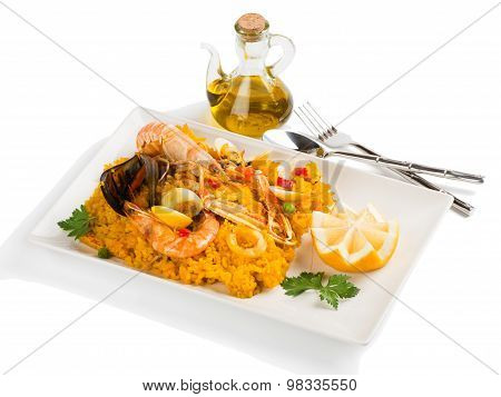 Paella With Seafood In A White Plate