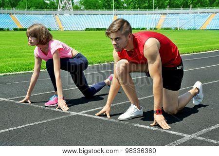 Runners in start position on stadium