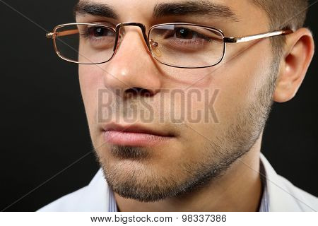 Attractive young man with glasses close up