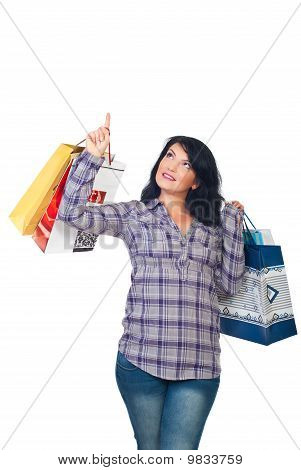 Woman With Shopping Bags Pointing Up