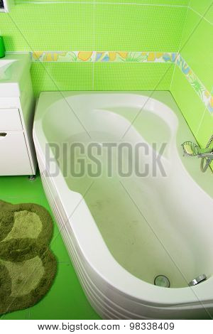Green bathroom interior. Corner bath