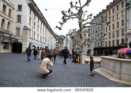 People Walking On The Street In Historical Center Of Geneva, Switzerland.