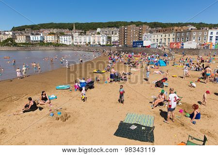 Marine lake beach Weston-super-Mare Somerset with tourists and visitors enjoying the August summer