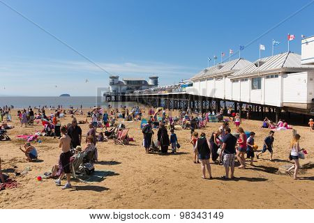 British summer scene Weston-super-Mare beach and pier Somerset with tourists and visitors in sun