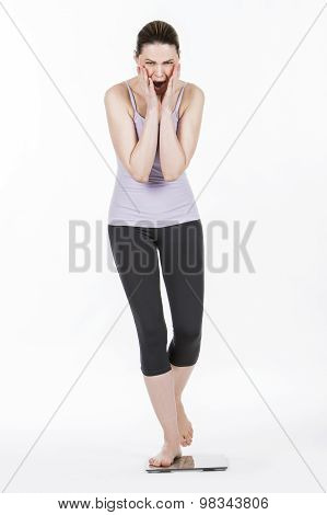 woman weighing herself on the balance