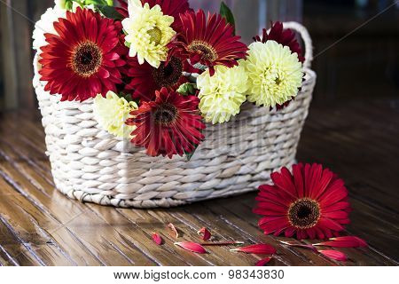 Basket of Red and Yellow Flowers