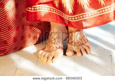 Legs decorated with indian mehandi painted henna close up