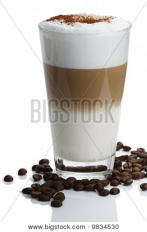 latte macchiato with coffee beans on white