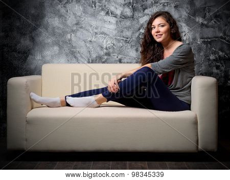 Young girl on sofa at dark room