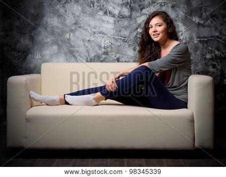 Young girl on sofa at dark room