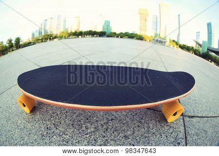 skateboard on city shot on fish eye