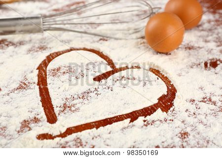 Eggs and corolla on flour background