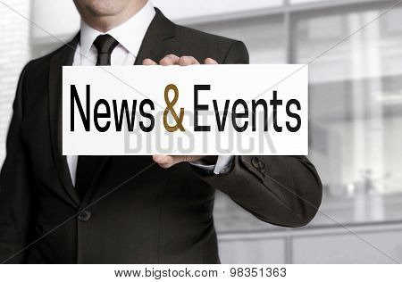 News And Events Sign Is Held By Businessman