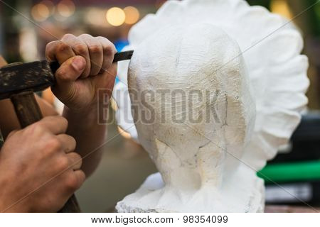 Man Carving Stone Statue