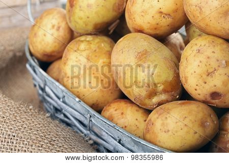 Young potatoes in baskets close up