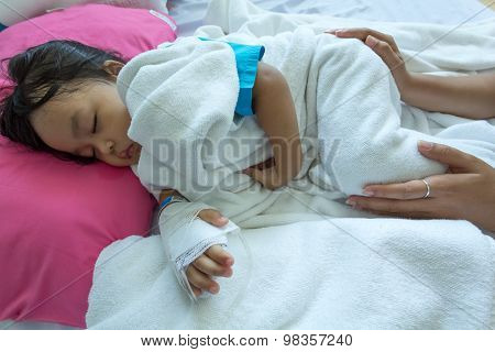 Illness Asian Kids Asleep On A Sickbed In Hospital, Saline Intravenous (iv) On Hand