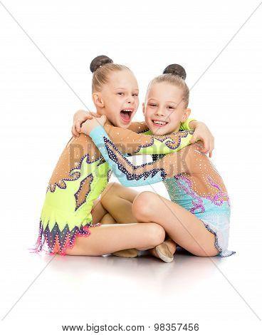 Little gymnasts hug