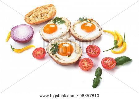 Fried chicken eggs in roasted potato shells, isolated on white background