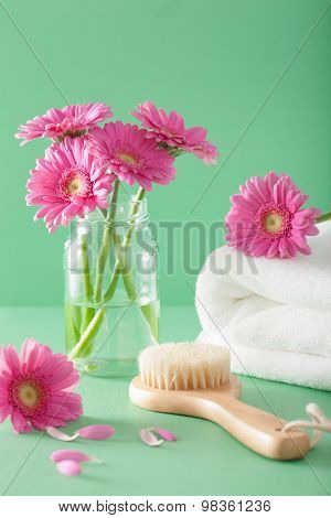 spa aromatherapy with gerbera flowers towel brush