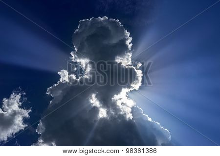 Dark thundercloud with sunbeams
