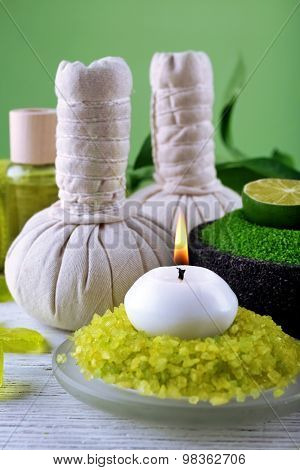 Spa still life in green color on wooden table, closeup