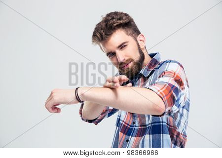 Casual man showing gun gesture with hands isolated on a white background