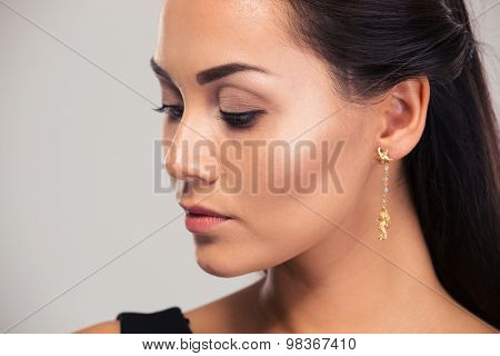 Jewerly concept. Portrait of a pretty female model looking away isolated on a white background