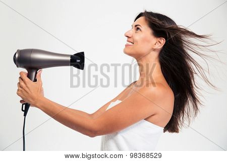 Happy beautiful woman in towel drying her hair isolated on a white background