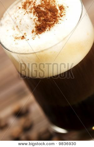 soft focus on milk froth of an espresso coffee with cocoa powder