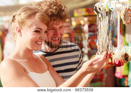Young Couple Buying Souvenirs Outdoor