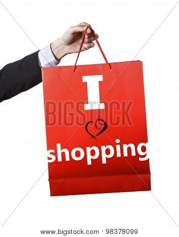 Man Hand Carrying And Showing A Red Bag Isolated On White Background I Love Shopping Motto