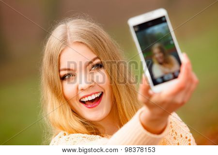Girl Taking Self Picture With Phone Outdoors