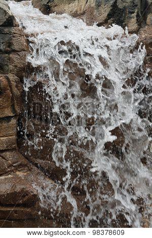 Waterfall splashing down rocks
