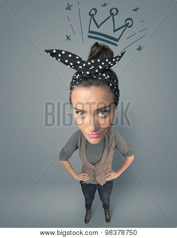 Funny girl with big head and drawn crown over it