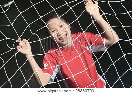 A female soccer player in a stadium