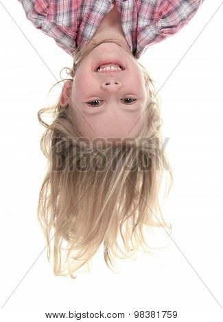 Happy 4 years old girl hanging upside down isolated on white wit