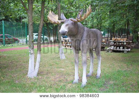 MOSCOW - AUG 13, 2014: Garden sculpture elk in the territory of College of Hospitality and Management in Moscow