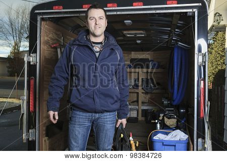 Portrait of an happy worker with tool