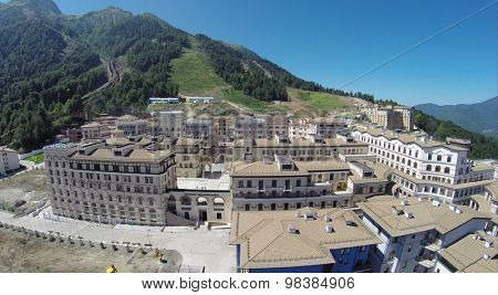 SOCHI, RUSSIA - AUG 2, 2014: Top view of the ski resort town Gorki Gorod at an altitude plus 960 meters above sea level, aerial view