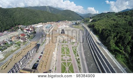 SOCHI, RUSSIA - AUG 1, 2014: The new building of hotel complex Gorky Gorod Apartments in Krasnaya Polyana, aerial view