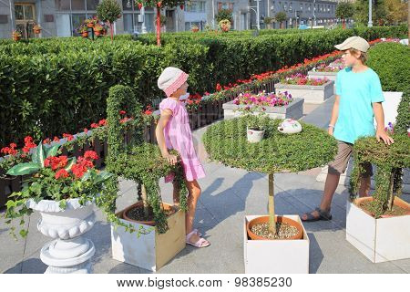 MOSCOW - AUG 12, 2014: Boy and girl walking by happy labyrinth on Tverskaya Square in Moscow festival jam