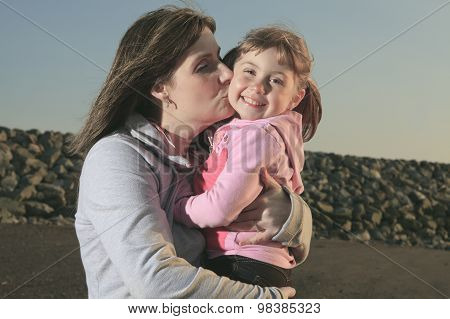 Photo of kissing happiest mother and daughter