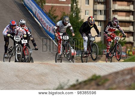 ST. PETERSBURG, RUSSIA - AUGUST 6, 2015: Unidentified bikers in the BMX race Cruiser. The competitions is a stage of the BMX racing championship of Russia
