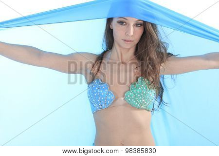 A belly dancer over a white background